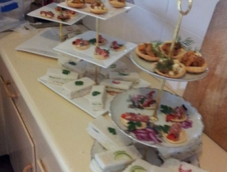 Display of trays set up for a High Tea